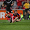 Replacement winger Anthony Horgan, in his last game for Munster, dives over for the province's fifth and final try