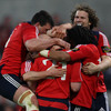 Anthony Horgan, a very popular member of the Munster squad, is mobbed by his team-mates after scoring a late try
