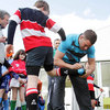 Fergus McFadden signs the boot of one young player