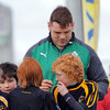 Ireland prop Mike Ross signs autographs at the Aviva Mini Rugby Festival