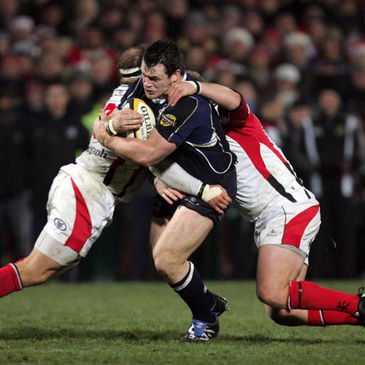 Leinster prop Cian Healy is tackled by Ulster's BJ Botha and Tom Court