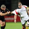 Ulster's Springbok prop BJ Botha carries the ball on, with Dragons front rower Rhys Thomas for company