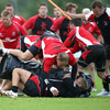 BJ Botha goes over the top of a ruck as Ulster's new forwards coach Jeremy Davidson guides the players through a drill