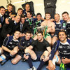 The Leinster backs clamber together for a commemorative photograph with the Heineken Cup trophy
