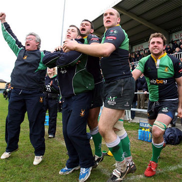 The Ballynahinch management and players celebrate at the final whistle