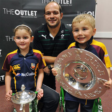Rory Best poses with the trophies and two young Banbridge fans