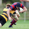 Flanker Barry O'Mahony, a try scorer for Clontarf against Blackrock last week, is caught in possession by Young Munster's Mark Rowley