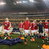 Jamie Heaslip and the rest of the Lions bench react as Leigh Halfpenny's last-minute kick heads towards the posts