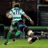 Benetton Treviso winger Bejamin de Jager tries to keep the ball in play, under pressure from Leinster's Dominic Ryan