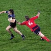 Glasgow full-back Bernardo Stortoni tries to slip by the outstretched arm of Alan Quinlan