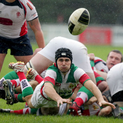 Bective's Brad Allam gets his pass away