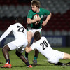 Ireland Under-20 centre Brendan Macken looks for support as he is tackled by English replacement Jordi Pasqualin