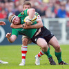 Connacht prop Brett Wilkinson is caught in possession by Chris Henry, Ulster's blindside flanker