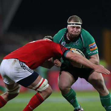 Connacht's Brett Wilkinson charges into Munster lock Mick O'Driscoll