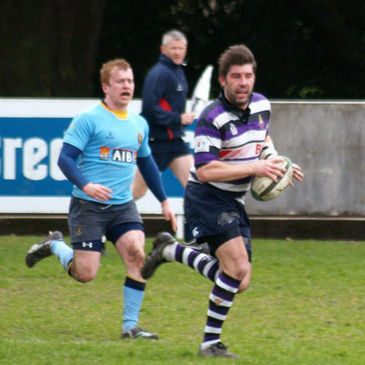 Terenure hooker Brian Blaney outpaces the UCD cover