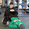 Brian O'Driscoll assists Luke Fitzgerald as the pair go through some stretching exercises before the pitch session with the squad