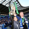 Brian O'Driscoll gets a helping hand from his fiancee Amy Huberman as they lift the Heineken Cup together