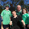 Ireland captain Brian O'Driscoll takes a break from signing autographs to be photographed with the fans