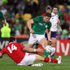 Into the closing stages, Brian O'Driscoll is pictured trying to flick the ball away a lunging George North