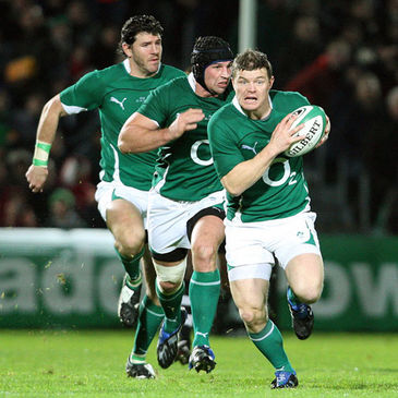 Brian O'Driscoll is supported by Shane Horgan and Denis Leamy