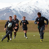 The snow-peaked mountains are visible in the background as Ireland captain Brian O'Driscoll tries to set up an attacking move