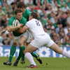 France number 8 Louis Picamoles tackles Ireland skipper Brian O'Driscoll, who has Donncha O'Callaghan in support