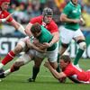 It was a helter skelter start from both teams. Ireland captain Brian O'Driscoll is pictured being tackled by Wales' Dan Lydiate and Rhys Priestland
