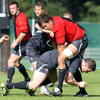Recent debutant Mike McCarthy is on defensive duty as Brian O'Driscoll goes to ground