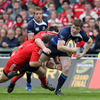 Brian O'Driscoll looks for a potential offload as Munster's Marcus Horan and James Coughlan tackle him