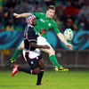 Brian O'Driscoll kicks the ball ahead under pressure from Takudzwa Ngwenya, who burst onto the scene at the last World Cup in France