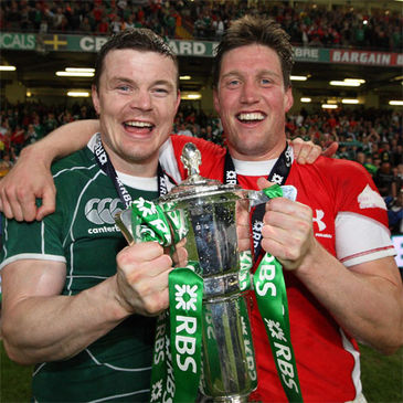 Brian O'Driscoll and Ronan O'Gara celebrate with the trophy