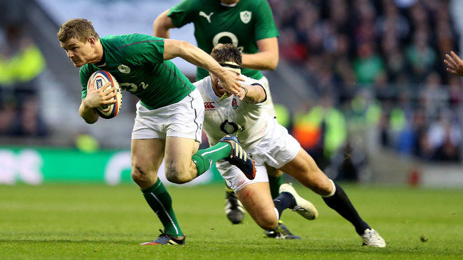 Brian O'Driscoll tries to break away from Tom Wood