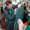 Brian O'Driscoll is pictured signing a banner for some Ireland supporters, who clapped and cheered the players on their arrival in New Plymouth