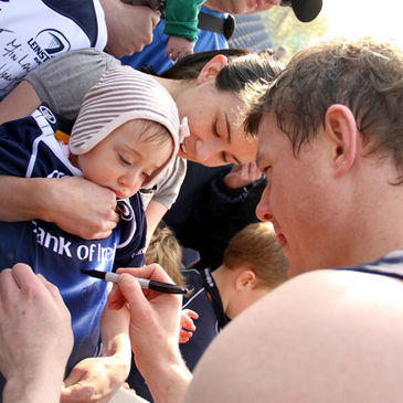 Brian O'Driscoll signs an autograph for a young Leinster fan