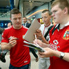 Brian O'Driscoll, a veteran of four Lions tours, stopped to sign autographs for some of the supporters who waited for the players