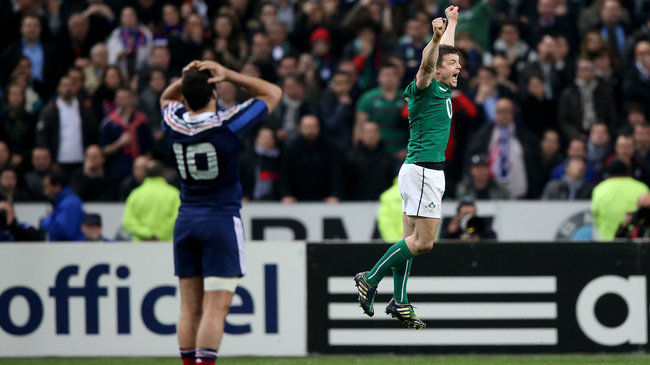 Ireland's Brian O'Driscoll jumps for joy after the final whistle