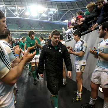 Brian O'Driscoll leads the Ireland players off after last Sunday's win