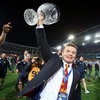 A beaming Brian O'Driscoll holds the Tom Richards trophy aloft to the acclaim of the many Lions supporters in the stands
