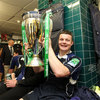 A very satisfied Brian O'Driscoll is photographed holding the trophy as Leinster take the celebrations into the dressing room