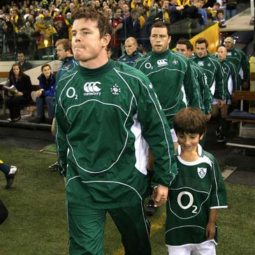 Brian O'Driscoll leads the Ireland team out against Australia