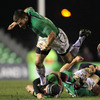 Winger Brian Tuohy tries to hold his balance as he is challenged by Harlequins' George Lowe