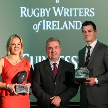 RTÉ's Michael Corcoran with award winners Niamh Briggs and Jonathan Sexton