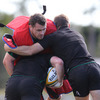 Cian Healy dons the tackle suit as the Ireland players get through some contact work