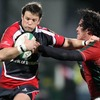 Ulster full-back Bryn Cunningham looks to hand off Portugal's Francisco Mira