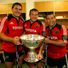 The starting Munster front row of Tony Buckley, Denis Fogarty and Federico Pucciariello pose with the trophy in the dressing room