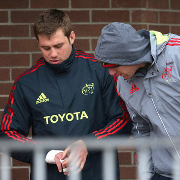 Paul O'Connell checks on CJ Stander's injured hand