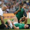 Physio Cameron Steele feeds through some information on Cian Healy's injury, as team doctor Eanna Falvey tends to the prop