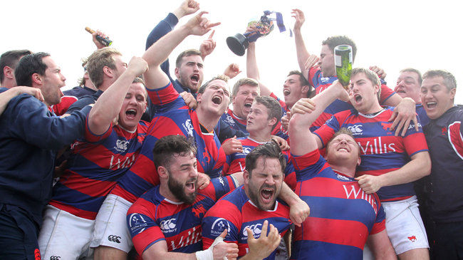 The Clontarf players and management celebrate