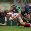 Ulster lock Ryan Caldwell is brought to ground by Harlequins prop Ceri Jones