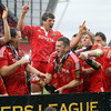 Damien Varley and Danny Barnes spray their team-mates as the Munster players enjoy that winning feeling